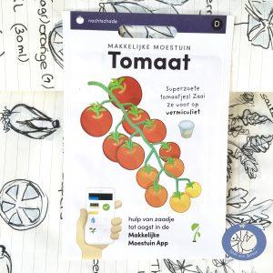 Product afbeelding van mijn getekend kookboekje met een los zakje zaden tomaat